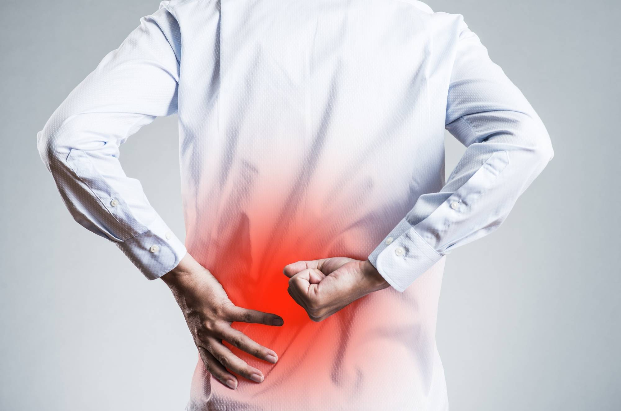 man experiencing low back pain